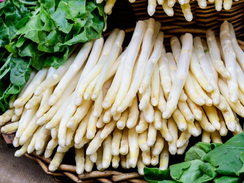 Fresh organic white asparagus in display for sale at a street food market