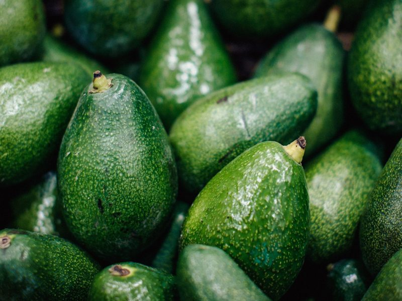 Textured many fresh, organic and green avocado fruits in full-frame background